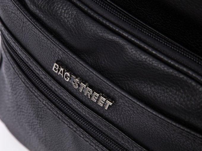 Metalowe logo z przodu torby
